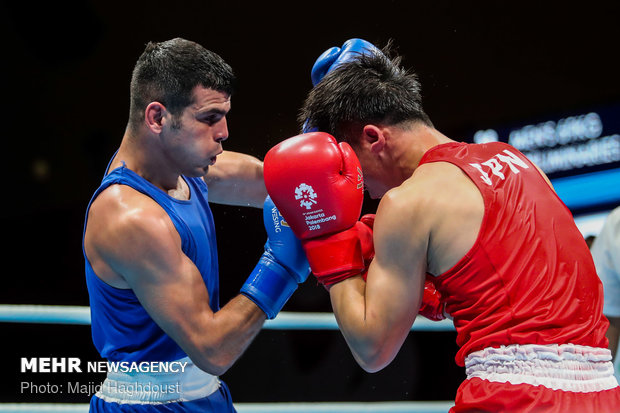 Iranian boxer defeats Japanese to reach quarterfinals at 2018 Asia Games