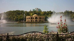 A view of Elgoli Park in Tabriz. Its fairground surrounds an artificial lake, in the middle of which stands tall a photogenic palace dating from the Qajar era.