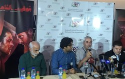 "Iranian director Ebrahim Hatamikia (3rd L) attend a meeting with a number of Syrian filmgoers after watching his latest movie ""Damascus Time"" at the Al Kindi Cinema in Damascus on August 29, 2018."