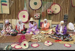 Iranian craftswomen weave traditional baskets during a national mat weaving festival at Fashtakeh village, Gilan province on September 6, 2018.