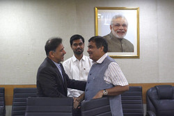 Iranian Minister of Transport and Urban Development Abbas Akhoundi (L) shaking hand with Indian Road Transport and Highways Minister Nitin Gadkari during a meeting in New Delhi on Thursday.