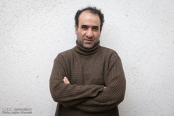Iranian writer Reza Amirkhani in an undated photo (Mehr/Asghar Khamseh)
