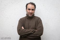 Iranian writer Reza Amirkhani in an undated photo (Mehr/Asghar Khamseh)