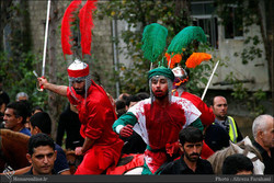 A group performs a tazieh (Iranian passion play) about Imam Hussein (AS) in the northern Iranian town of Ziabar on November 20, 2016