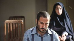 "Navid Mohammadzadeh (L) and Zakieh Behbahani act in a scene from ""No Date, No Signature"". (Photo by Amir-Hossein Shojaei)"