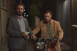 """Reza Attaran (L) and Javad Ezzati act in a scene from """"Centipede"""" by Abolhassan Davudi."""
