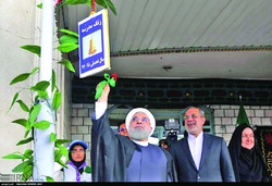 In a symbolic gesture President Rouhani rang the bell at a girls' high school in Tehran