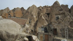 A view of the centuries-old Kandovan village in in East Azarbaijan. The village is filled with troglodyte homes in the shape of stony ice-cream cones that are still inhabited.