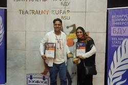 Director Farzin Nobarani (L) and actor Shabnam Eskandari pose after being honored at the 15th Teatralny Kufar International Student and Youth Theater Festival in Minsk, Belarus on September 28, 2018.