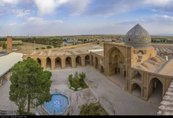 Photo depicts courtyard, arched arcades and tiled dome of the Jameh Mosque of Saveh in central Iran, October 4, 2018.