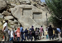 People visit Ganjnameh tourist resort complex in Hamedan province.  The site is home to Achaemenid-era rock carvings and natural attractions.