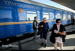 Luxury rail travelers on excursion across Iran