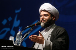 Hojjatoleslam Sheikh Mohammad Qomi, the chief of the Islamic Ideology Dissemination Organization delivering a speech at the first national conference on importance of family