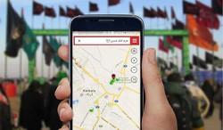 An Arbaeen pilgrim navigates shrine of Ima Hussain (AS) on the cellphone