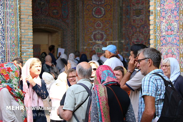 Autumn tourists visiting Nasir al-Molk Mosque in Shiraz