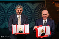 The Turkish-French academic Sami Erol Gelenbe (r) and the Iranian Professor M. Amin Shokrollahi pose with their awards they won at the Mustafa Prize 2017 on December 3,2017