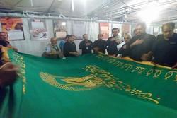 پرچم امام رضا (ع) تہران کے ولیعصر اسکوائر سے کربلائے معلی تک