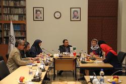 Farabi Cinema Foundation director Alireza Tabesh (c) and French MP Frederique Dumas (3rd R) meet in Tehran.