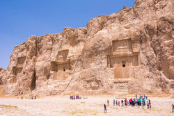 Travelers visit Naqsh-e Rostam, a massive Achaemenid-era necropolis, which is situated near Persepolis, southern Iran.
