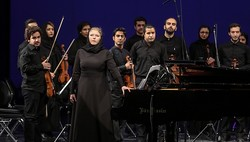 Polish conductor Martyna Kosecka is seen with Iran's Nilper Orchestra after doing a rehearsal at Tehran's Vahdat Hall.
