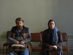 "Alireza Motamedi and Sahar Dowlatshahi act in a scene from ""Reza""."