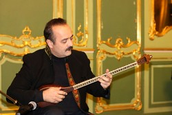 Iranian tar virtuoso Keyvan Saket performs in an undated photo.