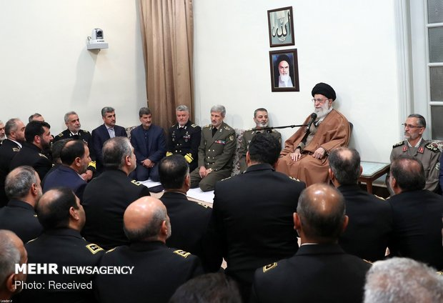 Leader receives Navy commanders, officials