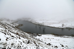 A view of a snow-covered lake in East Azarbaijan in mid-autumn