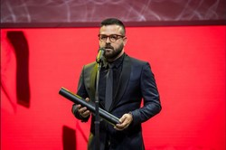 "Iranian director Hooman Seyyedi speaks after accepting the award for best actor on behalf of Navid Mohammadzadeh for his role in ""Sheeple"" during the closing ceremony of the Tallinn Black Nights Film"