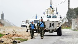 UN peacekeepers patrol the border with Israel near the village of Kfar Kila, Lebanon on December 4 [Ali Hashisho/Reuters]