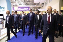 Iran's Minister of Information and Communication Technology (ICT) Mohammad Javad Azari Jahromi (2nd from r) and his Azeri counterpart Ramin Guluzade (3rd from r) visit Bakutel 2018, which was held fro