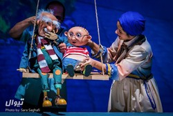 "Puppeteers Mohammad-Hadi Atai (L) and Elka Hedayat perform the puppet show ""Where Do We Come From?"" at Tehran's Honar Hall on November 11, 2018. (Tiwall/Sara Saqafi)"