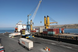 A container cargo being unloaded at Shahid Kalantari Port in Chabahar on December 2.