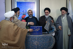 "Hojjatoleslam Mostafa Borujerdi (3rd L), Ayatollah Seyyed Mostafa Mohaqeq-Damad (4th L) and several unidentified clerics unveil ""Tafsir Shams"", a new Persian exegesis of the Holy Quran, at the Interna"