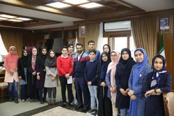ICT Minister Mohammad Javad Azari Jahromi (in the middle) pose for a photo with children that he discussed methods for online kid-friendly environment on Thursday