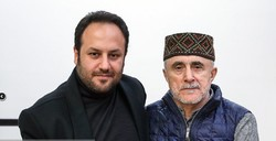 Iranian singer Shoeib Shahabi (L) and Azerbaijani musician Alim Qasimov attend a press conference at Tehran's Music Museum of Iran on December 23, 2018 to brief the media about their collaboration on