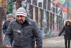 """Abdorreza Kahani (L) directs Reza Attaran in a scene from """"Free like Air""""."""