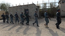 In this picture taken on November 21, 2018, Afghan policemen walk single-file as they display their skills at a police training centre on the outskirts of Jalalabad in Nangarhar. (By AFP)