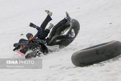 Snow tubing fun in central Iran