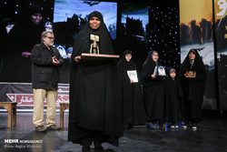 Daughter of Nigerian Shia leader Ibrahim Zakzaky holds a Golden Lantern she received from the 9th Ammar Popular Film Festival (APFF) on behalf of her father at Tehran's Andisheh Hall on December 30, 2
