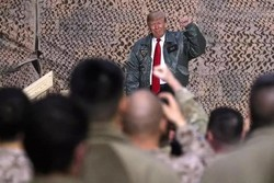 Trump says US troops to remain in Iraq to 'watch' Iran