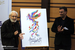 Actor Jamshid Mashayekhi (L) and the president of the 37th Fajr Film Festival, Ebrahim Darughezadeh, are seen after unveiling the official poster of the event in Tehran on January 4, 2019. (Mehr/Moham