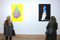 Art lovers visit the In Color of Life poster international exhibition at the Qasr Museum Garden on January 3, 2019. (Qasr Museum Garden/Elaheh Karimi)