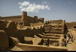 People visit the ruins of Rayen Castle in Kerman province