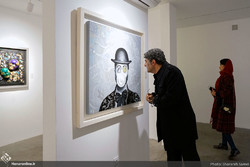 "An art aficionado visits an exhibition of paintings by Reza Alizadeh named ""Bubble"" at the Sayeh Gallery on January 14, 2019. (Honaronline/Sharareh Samei)"