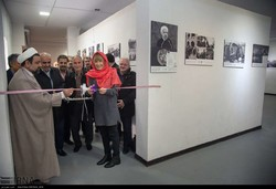 Maria Dotsenko (2nd R), director of the United Nations Information Centre (UNIC) in Tehran, cuts the ribbon to launch an exhibition of photos and documents on Iran-UN relations at the Shahid Avini Com