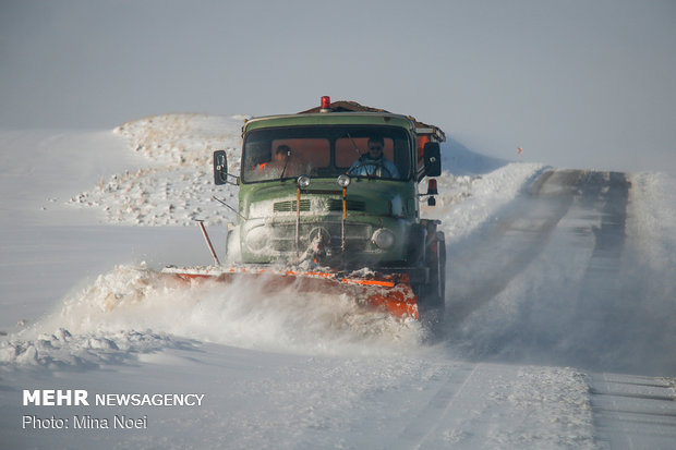 Snowplow crews clear snow from Golestan province's roads