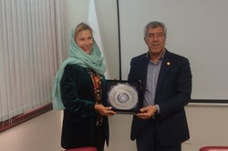 Sharif University of Technology President Mahmoud Fotouhi (R) and Swedish Ambassador to Tehran Helena Sangeland pose for a photo