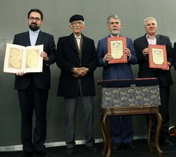 Calligrapher Gholamhossein Amirkhani (2nd L), Culture Minister Seyyed Abbas Salehi (3rd L)