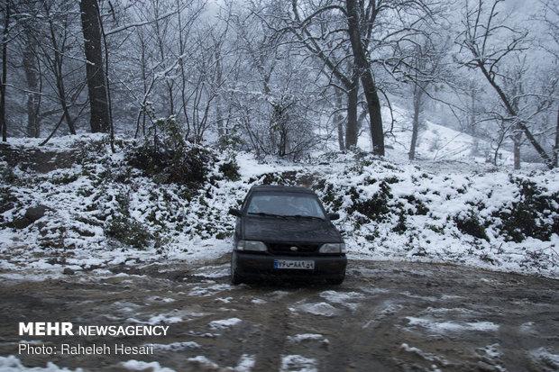 Snowplow crews clear snow rom Golestan province's roads
